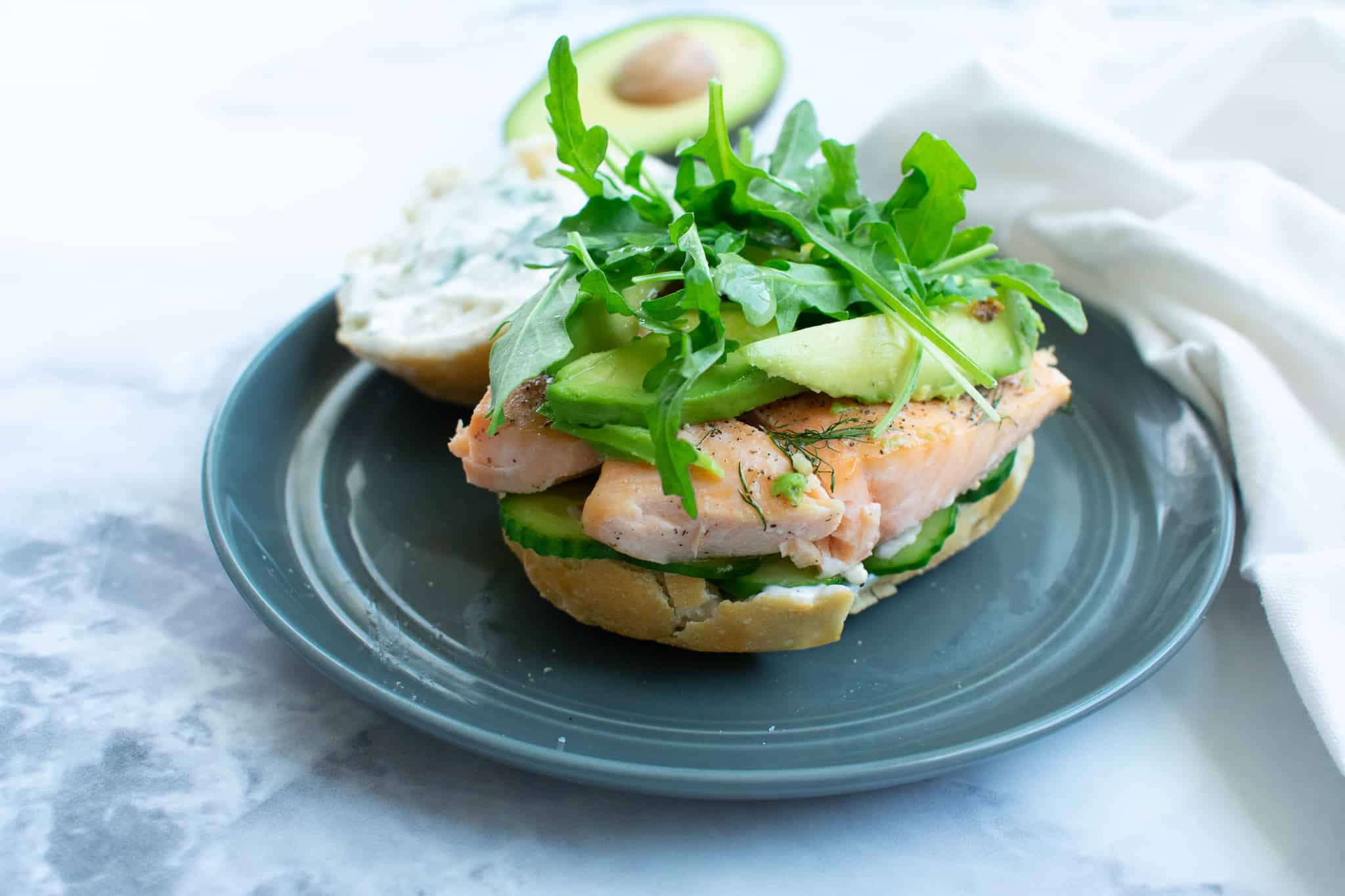 salmon sandwich on a gray plate