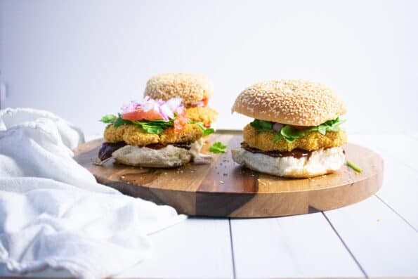 burgers on a wood tray with white background