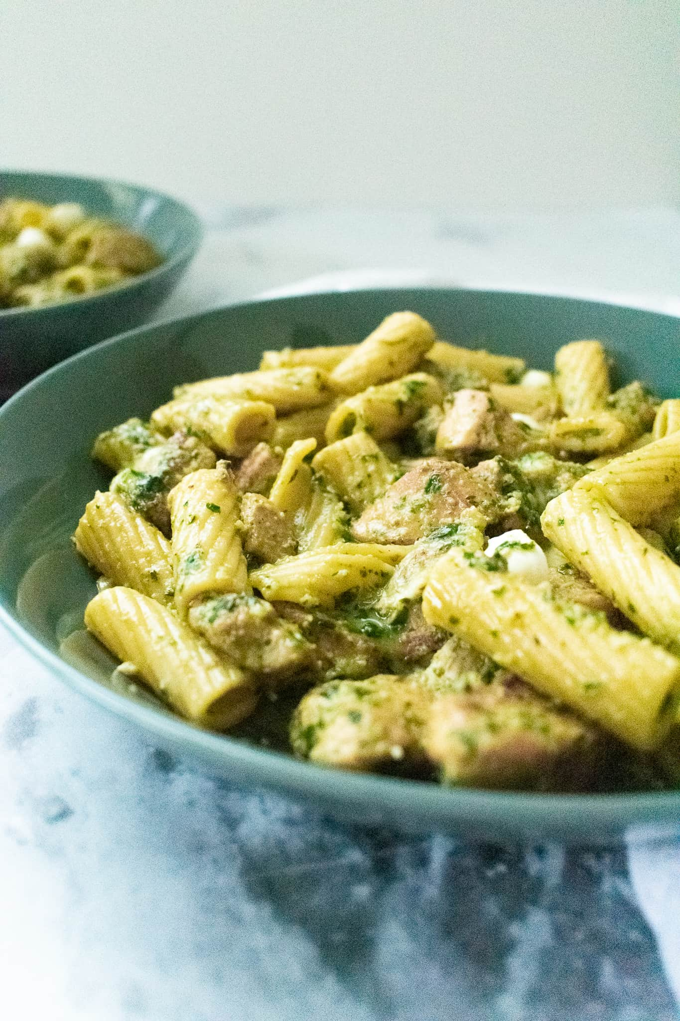 pesto pasta on gray plate