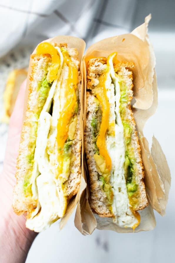 breakfast sandwich being held